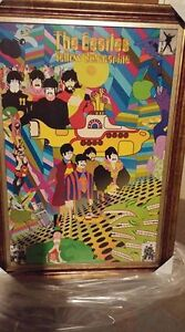 Large framed beatles poster and nesting doll