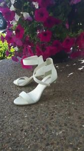 Fabulous! BCBG white shoes with silver heel