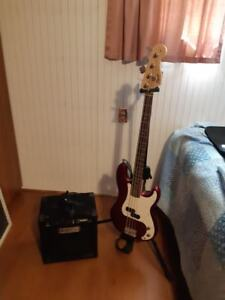 Squier P-bass, Fender Rumble 15 watt amp, carry case and stand