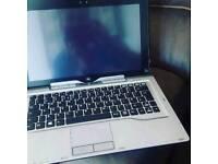 Fujitsu Q702 table or laptops