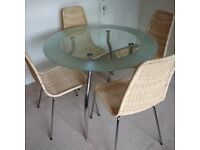 Set of four 'Linus' wicker chairs with detachable chrome-plated steel legs