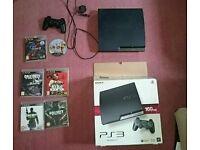 PlayStation 3 ps3 160gb slim plus games