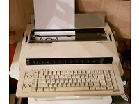 Brother CE-550 Electronic Typewriter with spare ribbons, daisy wheels & cover