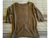 Gold jumper with embellishments