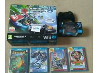 Nintendo Wii U plus 16 games and 2 pro controllers