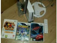 Nintendo wii complete console with 3 games and wii wheel