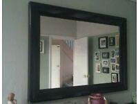 Black framed large mirror