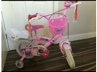 Girls peppa pig 12 inch bike with stabilisers, dolls seat, basket, bell, fringed handle bars £30 Ono
