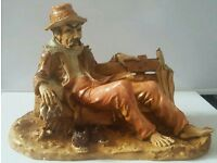 Large man sat on bench ornament