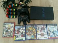 Ps2 complete console with 5games memory card and buzz controls