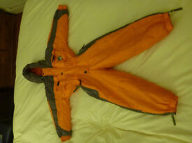One-piece Child's Kokodo orange snow suit, fits 4-5 years, 110cm. Get ready for cold weather!