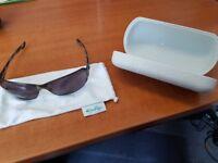 Genuine Oakley Metal Ladies Sunglasses and Hard case.