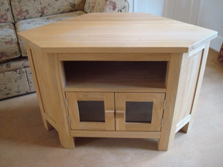 Corner TV Unit in Light Oak with extra recess/shelf and cupboard with glass doors