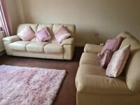 X2 cream leather sofas 2 seater and 3 seater