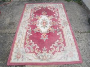 Hand-made Wool  5' X 7.5' Area Rug, used good condition