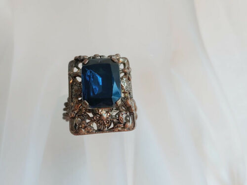 VINTAGE CZECHOSLOVAKIA BLUE STONE RING SCROLLED GOLD TONE RING MARKED SZ 7 #B
