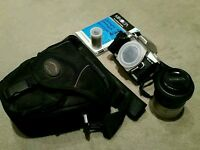Minolta Dynax 4 SLR Camera and lens, with film and case