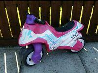 Girls balance motorbike