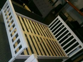 A brand new stylish white finish wooden double bed frame.