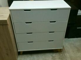A brand new white fish 4 drawer chest with stylish oak finish legs.