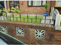 Wrought iron railings/brick wall tops