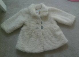 Girls cream coat 6-9 mths