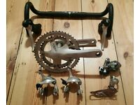 For sale is a Shimano Sora/Tiagra groupset.