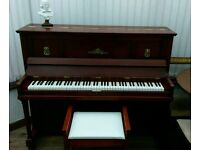 Upright piano with stool.