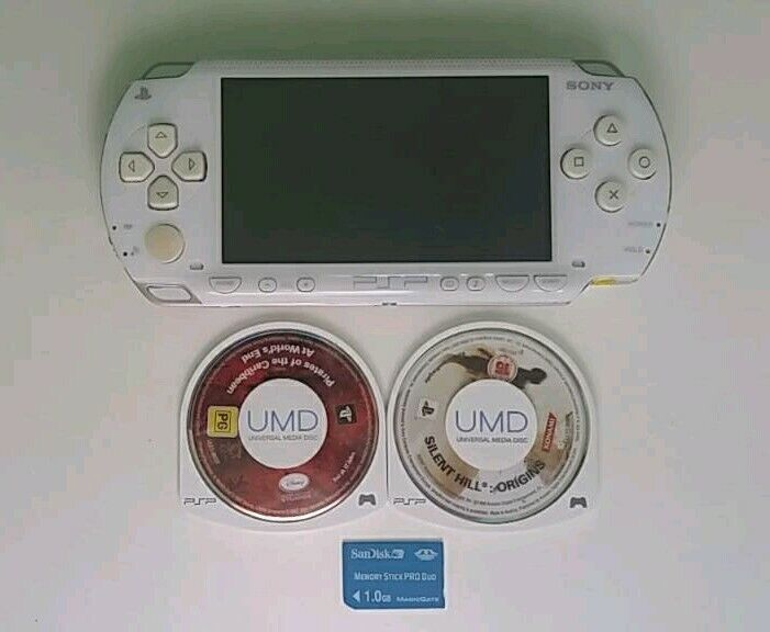 White Sony psp 1003 + 2 games and 1gb memory card | in Rumney, Cardiff |  Gumtree