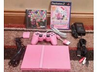 PINK PS2 SLIM, ALL LEADS & 2 GAMES - PLAYSTATION 2 MODEL NO. SCPH-77003