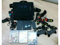 Play satation 2 complete console with extras with carry cases