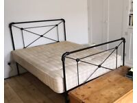 Double bed with metal frame including mattress