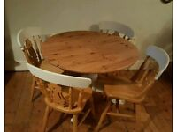 Solid pine table and 4 chairs (free local delivery)