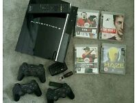 PS3 Console with controllers and games