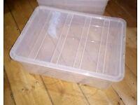 FIVE CLEAR PLASTIC STORAGE BOXES