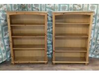 two pine bookshelves