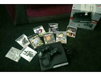 Playstation 3 PS3 slim 320gb + 2 controllers + 9 games in excellent condition