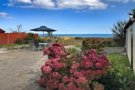 REDUCED NEW YEAR break & view of the sea Norfolk dog friendly holiday cottage WINTERTON NOT YARMOUTH