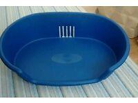 Blue small to medium sized plastic dog basket bed