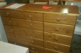 A brand new pine 12 drawer chest.