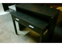 A brand new black finish 2 drawer console table.