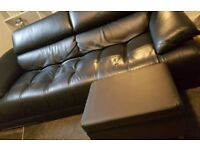 Black leather sofa with foot stool