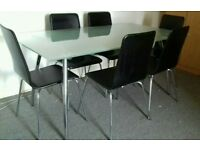 Glass table and 6 black faux leather chairs