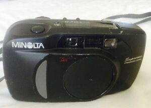 Minolta camera with case and stand