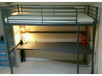 Metal loft bed frame with desk top and mattress