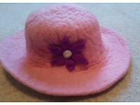 Pink felt hat with flower