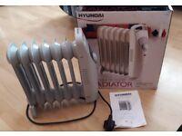 Hyundai 800w mini oil filled radiator used once