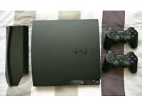 PS3 with 2 controllers and 30 games