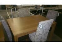 A brand new 120cms dining table with 2 grey x 2 cream fabric dining chairs.