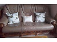 Beige three seater sofa